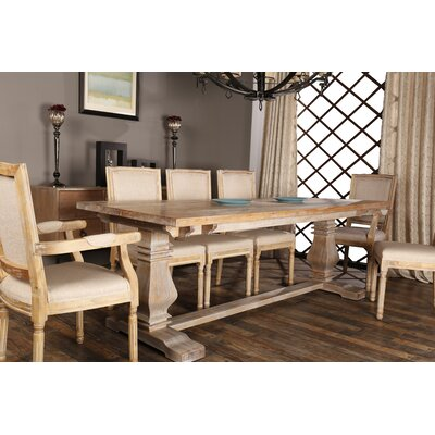 Raymund Distressed Upholstered Dining Chair Frame Color: Antique Beige
