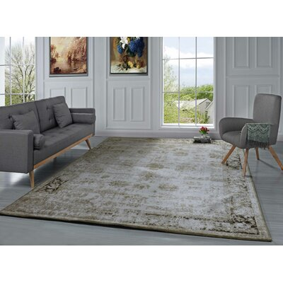 Gloria Persian Distressed Beige Area Rug Rug size: 5 x 7