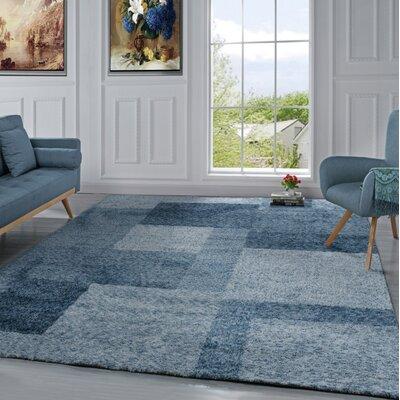 Harrill Geometric Blue Area Rug
