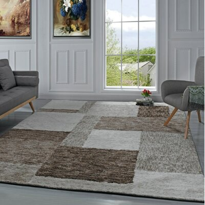 Harrill Geometric Brown Area Rug