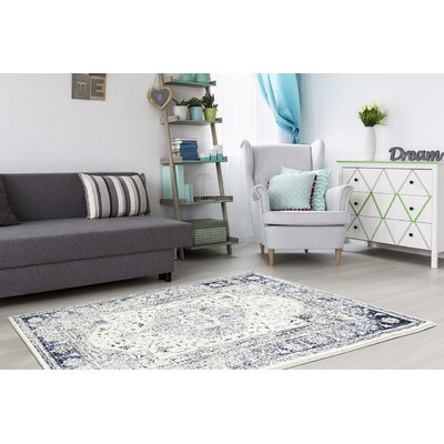 Burwell Distressed Ivory Area Rug Rug Size: Rectangle 71 x 106