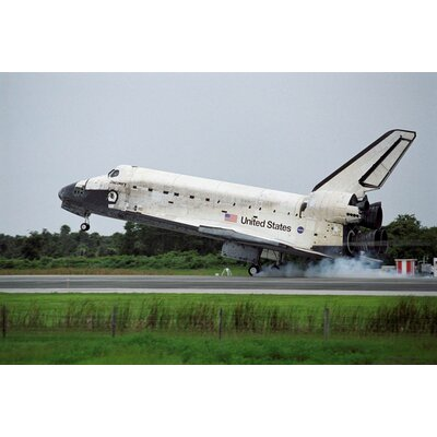 "Shuttle Discovery Landing Glossy Wall Mural Size: 16"" H x 24"" W x 0.1"" D space14-p24"