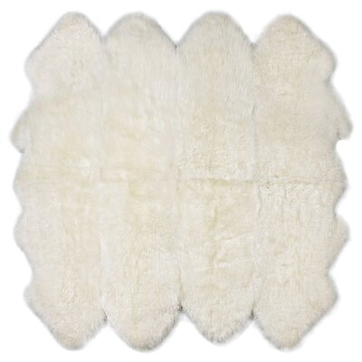Eight Pelt Ivory Area Rug
