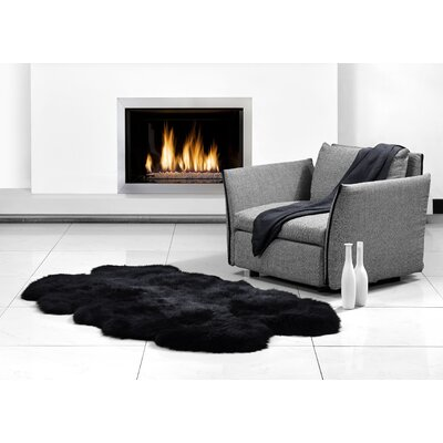 Four Pelt Black Area Rug