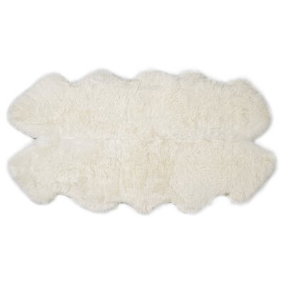 Four Pelt Ivory Area Rug