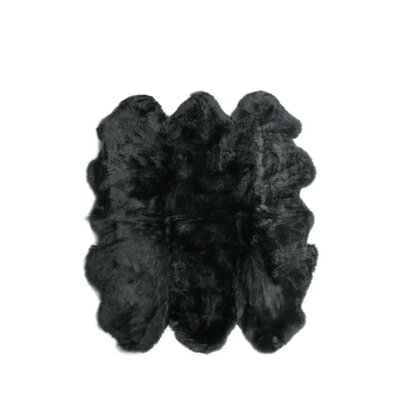Six Pelt Black Area Rug