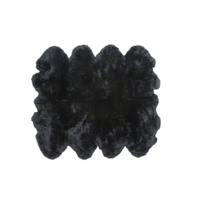 Eight Pelt Black Area Rug