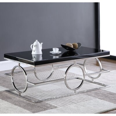 Santamaria Coffee Table Base Finish: Silver, Top Finish: Black