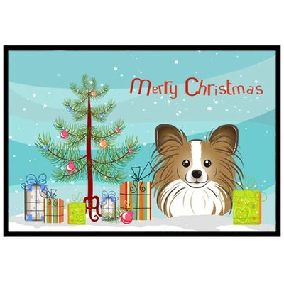 Christmas Tree and Papillon Doormat Rug Size: 2 x 3