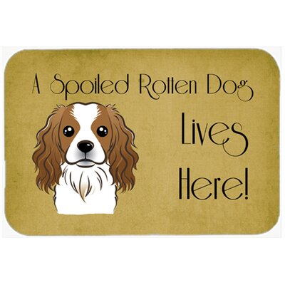 Cavalier Spaniel Spoiled Dog Lives Here Kitchen/Bath Mat Size: 24