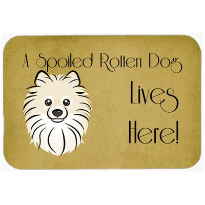 Pomeranian Spoiled Dog Lives Here Kitchen/Bath Mat Size: 24 W x 36 L