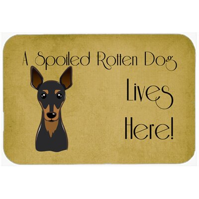 Min Pin Spoiled Dog Lives Here Kitchen/Bath Mat Size: 24