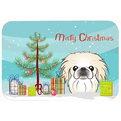 Christmas Tree and Pekingese Kitchen/Bath Mat Size: 24 W x 36 L