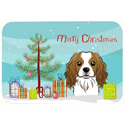 Christmas Tree and Cavalier Spaniel Kitchen/Bath Mat Size: 24 W x 36 L