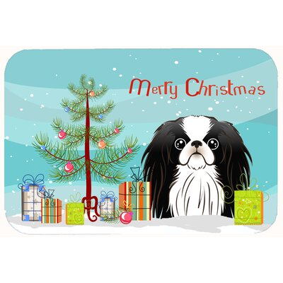 Christmas Tree and Japanese Chin Kitchen/Bath Mat Size: 24 W x 36 L