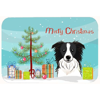 Christmas Tree and Border Collie Kitchen/Bath Mat Size: 20 W x 30 L