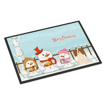 Merry Christmas Carolers Cavalier Spaniel Doormat Mat Size: Rectangle 2 x 3