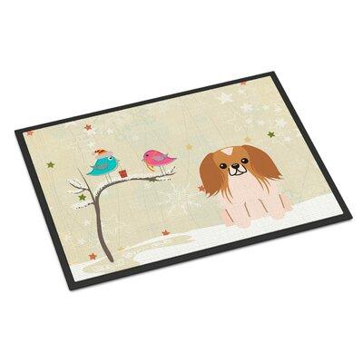 Christmas Presents Between Friends Pekingnese Doormat Mat Size: Rectangle 2 x 3