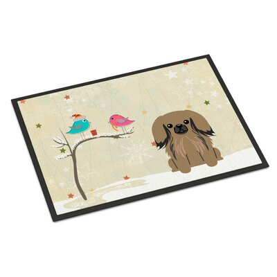 Christmas Presents Between Friends Pekingese Doormat Rug Size: Rectangle 16 x 23