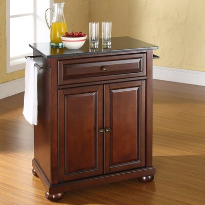 Pottstown Solid Black Granite Top Portable Kitchen Island Base Finish: Vintage Mahogany