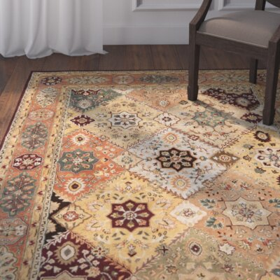 Heine Hand-Tufted Red / Rust Area Rug