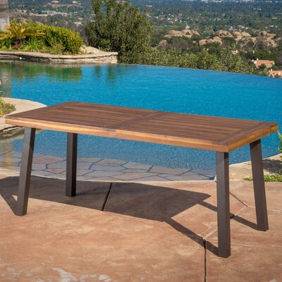 Isidore Outdoor Wood Dining Table Finish: Natural Stain