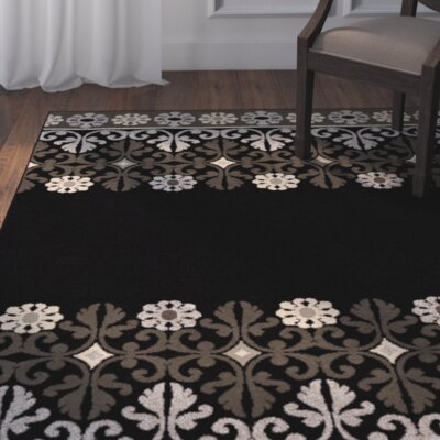Plaines Black Area Rug