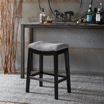 Henninger Bar Stool Finish: Black, Upholstery: Gray, Nailhead Finish: Silver