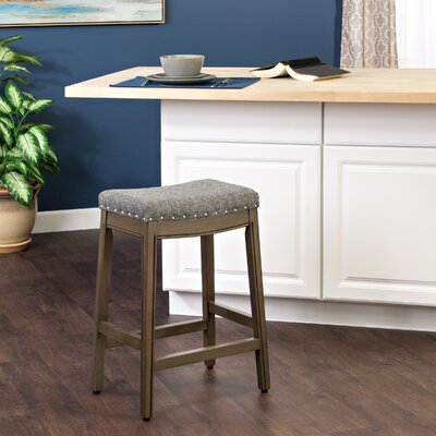 Windham Bar Stool with Cushion Finish: Honey Oak, Upholstery Color: Marine / Natural