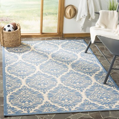 Sherell Cream/Blue Area Rug Rug Size: Rectangle 51 x 76