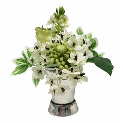 White and Green Flowers in a Mint Julep Cup