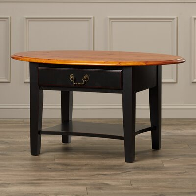 Revere Coffee Table Finish: Brown Cherry / Black