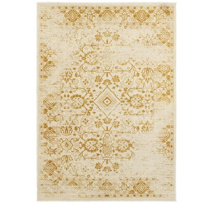 Ravenwood Beige/Gold Area Rug Rug Size: Rectangle 53 x 76