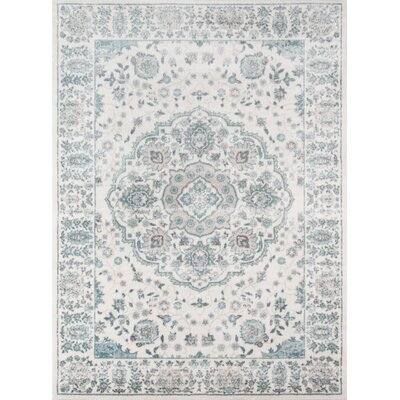 Kinsley Blue/Ivory Area Rug Rug Size: Rectangle 93 x 126