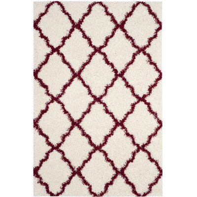 Brentwood Beige/Red Area Rug Rug Size: Rectangle 4 x 6