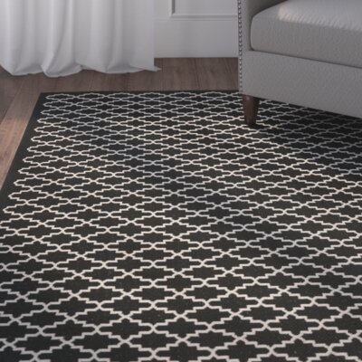 Alcott Hill Bexton Black / Beige Outdoor Rug