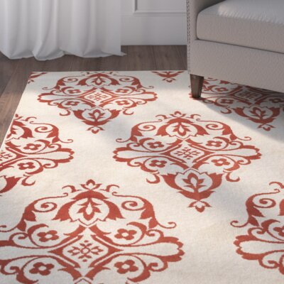 Ravenwood Beige/Red Area Rug Rug Size: Rectangle 67 x 96