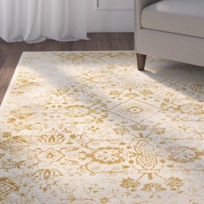 Ravenwood Beige/Gold Area Rug Rug Size: 53 x 76