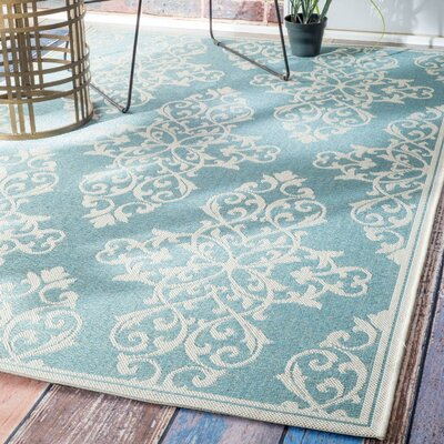 Lantz Turquoise Indoor/Outdoor Area Rug Rug Size: 86 x 122