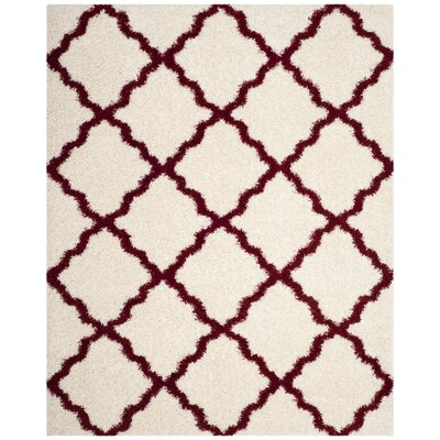 Brentwood Beige/Red Area Rug Rug Size: Rectangle 8 x 10