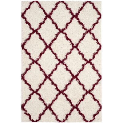 Brentwood Beige/Red Area Rug Rug Size: Rectangle 51 x 76