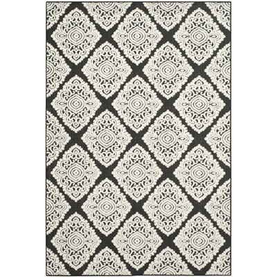 Mannox Black/Cream Indoor/Outdoor Area Rug Rug Size: Rectangle 53 x 77