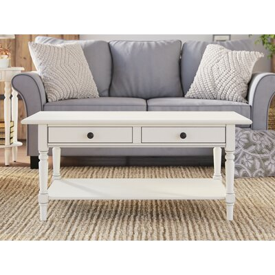 Hugh Coffee Table Color: Distressed Cream