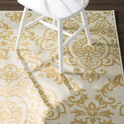 Carriage Hill Ivory/Gold Indoor/Outdoor Area Rug Rug Size: 19 x 39