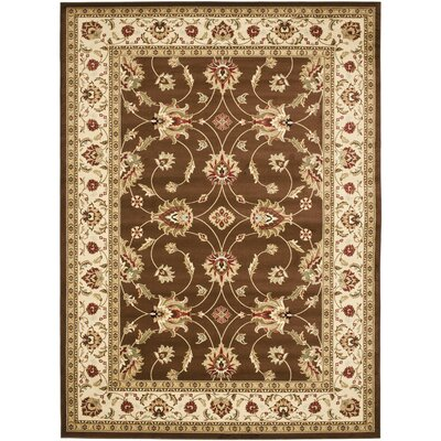 Ottis Brown/Ivory Persian Area Rug Rug Size: 89 x 12