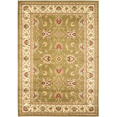 Ottis Green/Ivory Area Rug Rug Size: 67 x 96