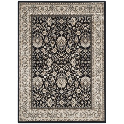 Petronella Black/Ivory Area Rug Rug Size: 51 x 77