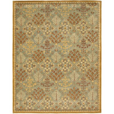Dunbar Light Blue/Gold Area Rug Rug Size: 96 x 136