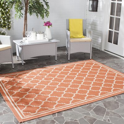 Octavius Orange Outdoor Area Rug Rug Size: 67 x 96
