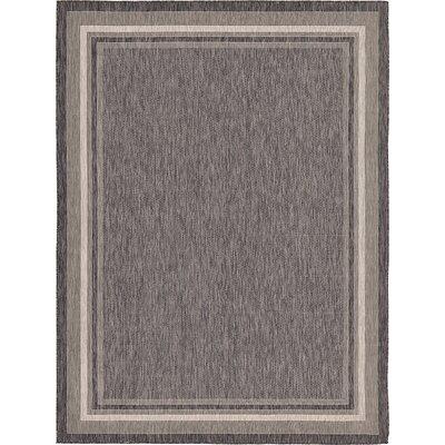 Ernest Black Outdoor Area Rug Rug Size: 9 x 12